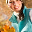 Beautiful autumn woman outdoors — Stock Photo