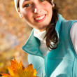 Beautiful autumn woman outdoors — Stock Photo #14970609