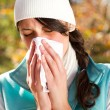 Stock Photo: Young woman season change allergy