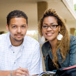 Zdjęcie stockowe: Two african american college students studying together
