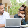 Two african university students with laptop on campus — Stock Photo