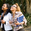 Two happy female african college students walking to classroom — Stock Photo