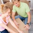 Young couple packing and moving house — Stock Photo