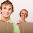 Happy young couple moving to new house — Stock Photo #15842435