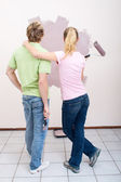 Young couple painting new home together — Stock Photo