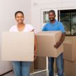 Happy african american couple moving in new home — Stock Photo