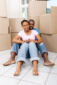 Young african couple moving to their new home — Stock Photo