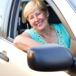 Senior female driver inside car — Stockfoto