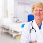Senior female doctor in hospital ward — Stock Photo