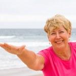Senior woman workout on beach — Stock Photo
