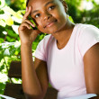 Thoughtful female african american college student studying outdoors — Stock Photo