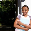 Female african student on campus — Stock Photo