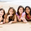 Group of teen girls lying on beach — Stock Photo