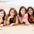 Group of teen girls lying on beach — Stock Photo #16335663