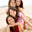 Group of teen girls having fun on beach — Stock Photo