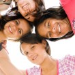 Group of teen girls looking down at camera — Stock Photo