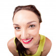 Wideangle distorted picture of funny young woman face - Stock Photo