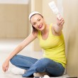 Cute young woman painting new home wall — Stock Photo