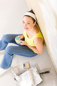 Above view of young woman choosing paint color for her new home — Stock Photo