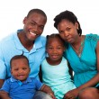 Stock Photo: Joyful african american family isolated on white