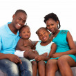 Happy african american family sitting on sofa — 图库照片