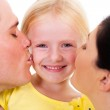 Parents kissing little daughter on white — Stock Photo