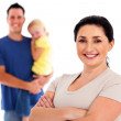 Happy young mother standing in front of family — Stock Photo