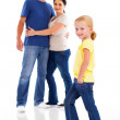 Happy young family on white with little girl in front — Stock Photo
