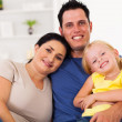Happy young family at home — Stockfoto #18713491