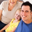 Overhead view of happy young family at home — Stock Photo