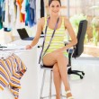 Attractive young female fashion designer sitting in her office — Stock Photo #18714425