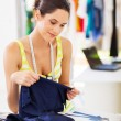 Pretty fashion designer choosing fabric for her new design — Stock Photo #18714479