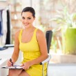 Beautiful female dressmaker drawing new design in studio — Stock Photo