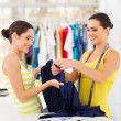 Two young female fashion designers choosing fabric — Stock Photo