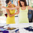 Stock Photo: Female dressmaker measuring client's bust size