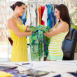 Happy dressmaker hand over a dress to her client — Stock Photo #18714633