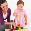 Little daughter playing educational toy with mother — Stock Photo