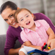 Happy mother and daughter at home — Stock Photo #18714919