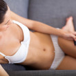 Sexy young woman in underwear reading sms — Stock Photo