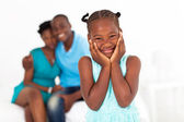 Cute african little girl standing in front of parents — Stock Photo