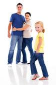 Szczęśliwą rodzinę młody na białym tle z małą dziewczynką z przodu — Zdjęcie stockowe