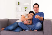 Young couple watching scary horror movie at home — Foto de Stock