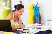 Pretty female fashion designer drawing new designs — Stock Photo