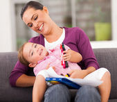 Happy mother playing with little daughter at home — Stock Photo