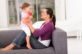 Happy mother and little daughter at home — Stock Photo