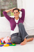 Pretty young mother relaxing at home — Stock Photo
