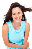 Happy young woman laughing over white background — Stock Photo