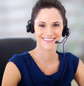 Pretty young telephonist with headphones closeup portrait — Stock Photo
