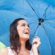 Happy beautiful woman under umbrella — Stock Photo