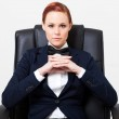 Cool fashion woman in suit sitting on office chair — Stock Photo #18838327